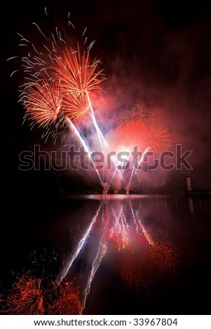 Fireworks on the river - stock photo