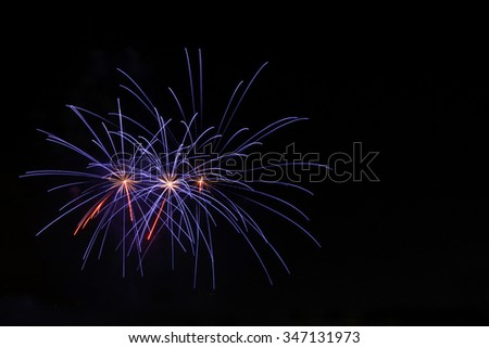 Fireworks or flares as explosive devices in category one. Features include sound, lighting of fireworks, flares, smoke and ash are designed to burn and ignite the light colors. - stock photo