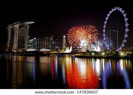 Fireworks over Marina bay in Singapore - stock photo