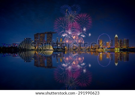 Fireworks over Marina bay in Singapore on National day rehearsal - stock photo