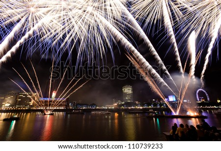 Fireworks over the River Thames in London - stock photo