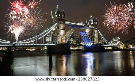 Fireworks over Tower Bridge, lifted, at night - stock photo