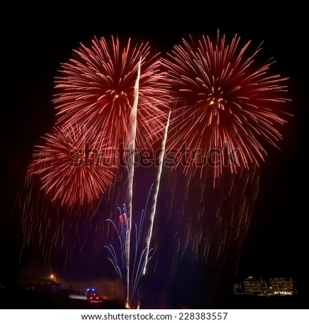 Fireworks. Red amazing fireworks isolated in dark sky background and coming car, Malta fireworks festival, 4 of July, Independence day, New Year, fireworks festival, holidays - stock photo