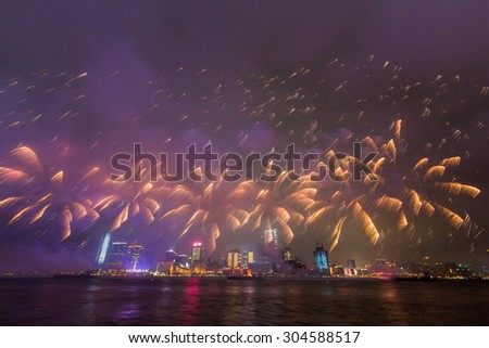 Fireworks Show along Victoria harbor in Hong Kong - stock photo