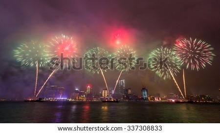 Fireworks show along Victoria harbor in Hong Kong, China - stock photo
