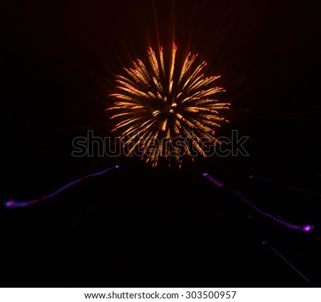 Fireworks Trails with a Blurred Zoom Lens Effect - stock photo