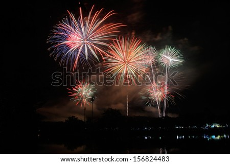 Fireworks with reflection in the lake - stock photo