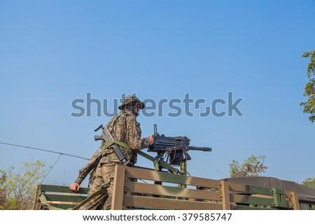 Firing a machine gun mounted on the car. - stock photo