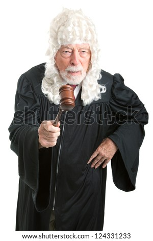Firm, angry British style judge with white wig, waving his gavel.  Isolated on white. - stock photo