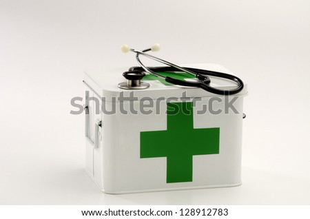 First aid box and a stethoscope in white background - stock photo