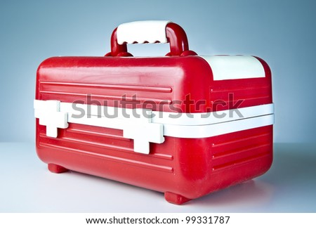 First aid box on a blue background - stock photo