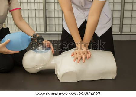 First Aid Instructor Showing Resuscitation CPR Technique  - stock photo