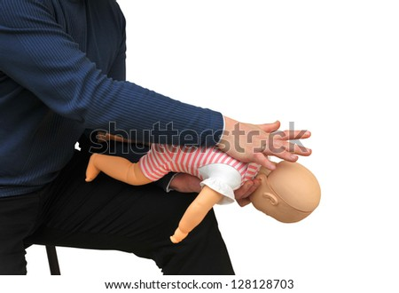 First aid instructor using infant dummy - stock photo