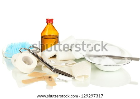First aid kit for bandaging isolated on white - stock photo