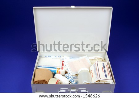 First aid kit open on a blue background - stock photo