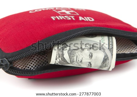 First aid kit with dollar. - stock photo