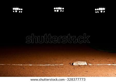 First base line under the stadium lights - stock photo