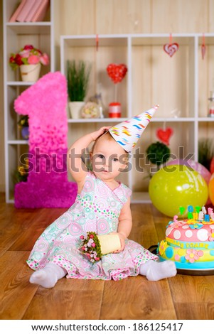First birthday of cute baby girl - stock photo