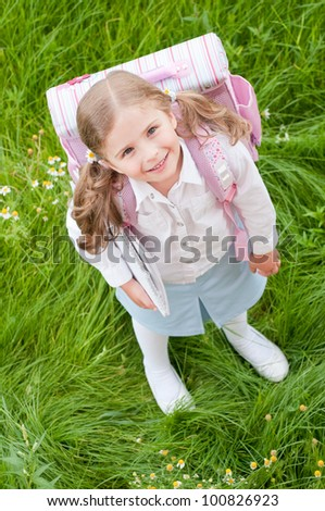 First day of school - outdoor portrait of lovely schoolgirl - stock photo