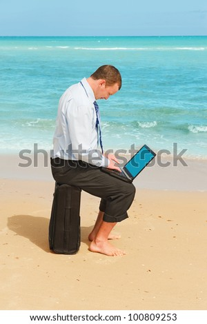 First day of vacation.Businessman  on the beach - stock photo