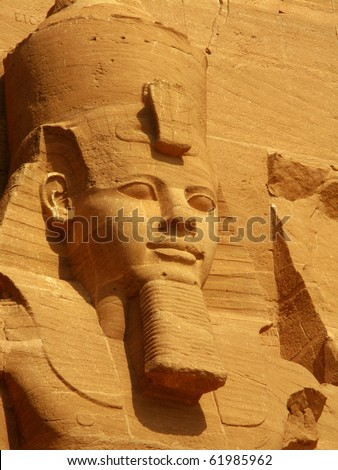 First head in Abu Simbel Temple of King Ramses II, a masterpiece of pharaonic arts and buildings in Old Egypt - stock photo