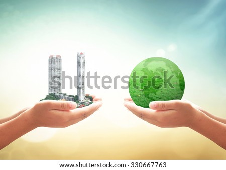 First, human hand holding the city. Second, human hand holding earth of grass over blurred nature background. Ecological City, World Environment Day, CSR, Go Green, Eco Friendly, Investment concept. - stock photo