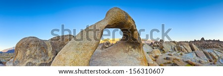 First light illuminating Mount Whitney and the Sierra Nevada mountains. Alabama Hills in California, which is a popular filming location for television and movie productions. - stock photo
