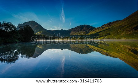 First Light on Buttermere in The Lake District, Cumbria, England - stock photo