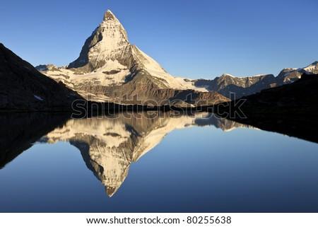 First light on the Matterhorn, one of the most beautiful icons of Switzerland, Pennine Alps, Switzerland, Europe - stock photo