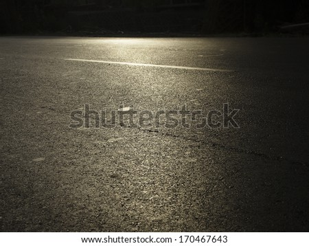 first morning sunlight on dark road in rural of india - stock photo