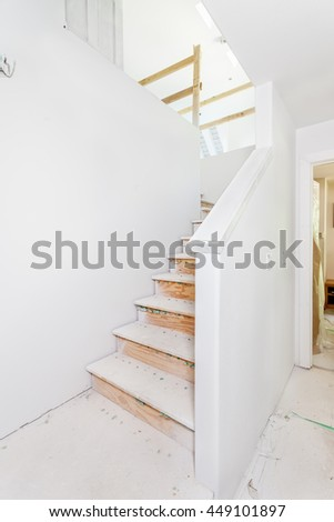 First part of trim work on new staircase - the cap on the lower drywall handrail - stock photo