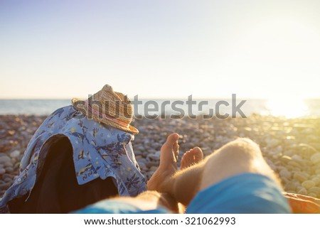 First person perspective of man legs on sunset beach. Travel concept - stock photo