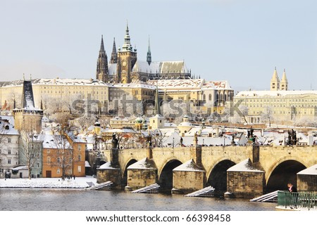 First Snow in Prague, gothic Castle with the Charles Bridge in the sunny Day - stock photo