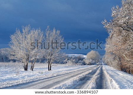 First snow on the road - stock photo
