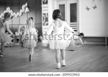 First steps of small ballerinas; monochrome - stock photo