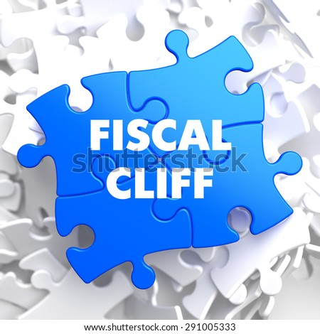 Fiscal Cliff on Blue Puzzle on White Background. - stock photo