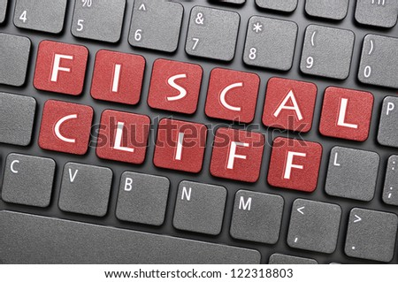 Fiscal cliff on keyboard - stock photo