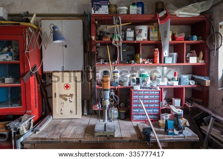 FISCHBACH, GERMANY - May 01 2015: Messy abandoned workshop - stock photo
