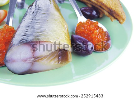 fish and caviar with toast on green dish - stock photo