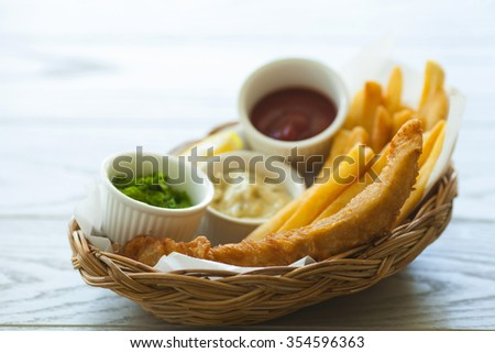 Fish and chips in the basket - stock photo
