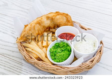 Fish and Chips with assorted sauce - stock photo