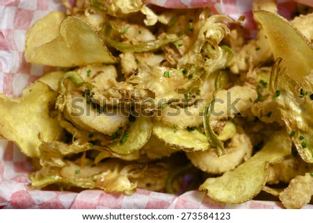 Fish and chips with checkered paper. - stock photo