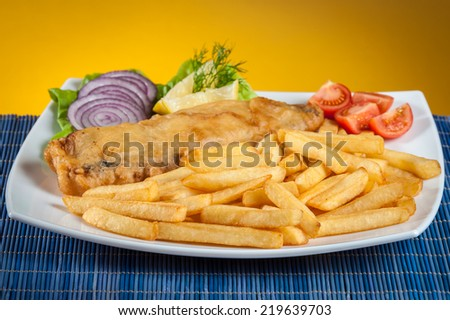 fish and chips with lettuce and tomato - stock photo