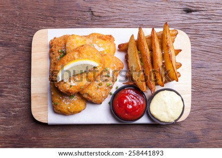 Fish and chips with potato wedge