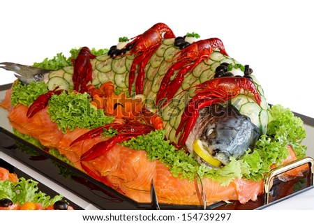 Fish and crabs on the festive table. - stock photo