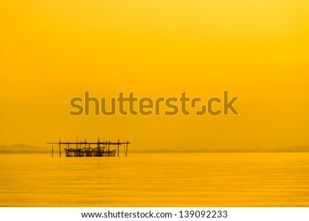 Fish cages./Silhouette in the image. - stock photo