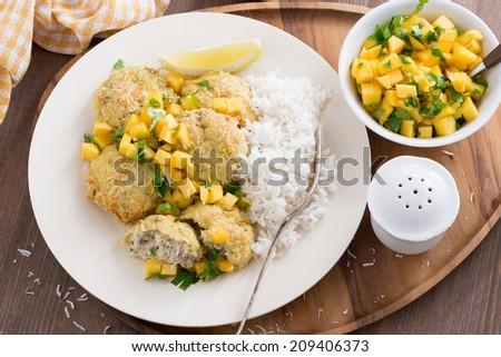 fish cakes with mango salsa and white rice, top view, horizontal - stock photo
