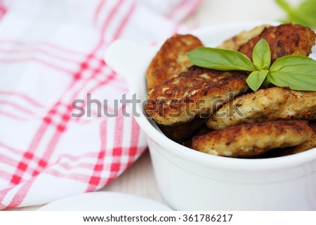 fish cutlets countrylike  in white ceramic saucepan - stock photo
