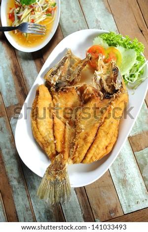 Fish dish - fried fish - stock photo