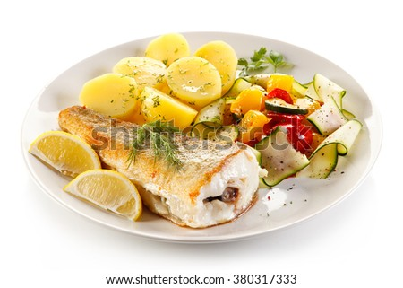 Fish dish - fried fish and vegetables  - stock photo